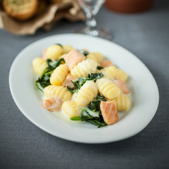 Salmon served with gnocchi and basil