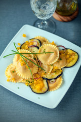 Tasty vegetarian cuisine with ravioli and eggplant