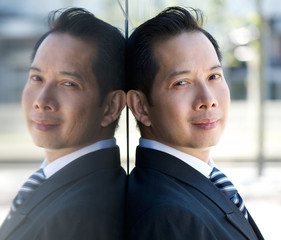 Asian businessman with mirror reflection