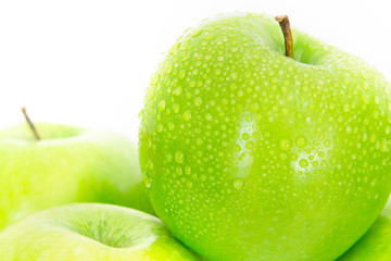 Close up fresh green apple with droplet