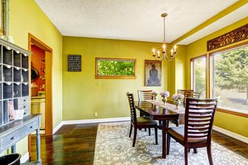 Bright yellow dining room