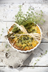 rustic vegetables french quiche with peas on baking dish