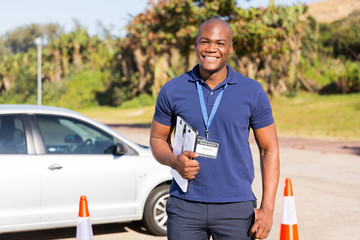 Fototapete - african american driving instructor in testing ground