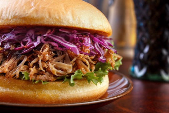 Pulled pork burger with red cabbage salad closeup