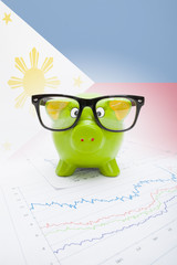 Piggy bank with flag on background - Philippines