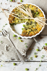 rustic vegetables french quiche on baking dish with fork
