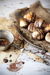 coconut macaroons with dripped dark chocolate and cocoa powder