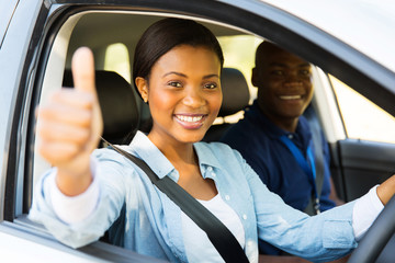 Fototapete - female african learner driver giving thumb up
