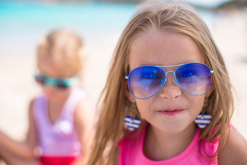 Adorable little girls at beach during summer vacation