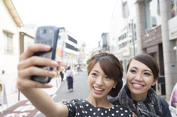 Young woman taking a photograph on a mobile phone