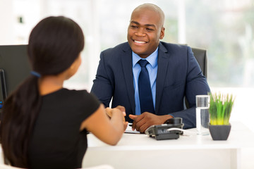 african american businessman handshaking with client