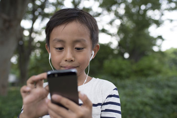 Boy using a smartphone outside