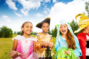 Kids dressed wearing Halloween costumes in park