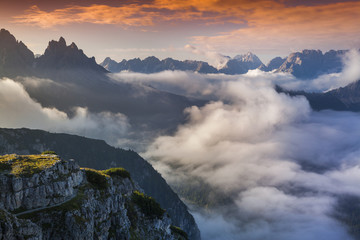 Wall Mural - Foggy summer sunrise in the Italian Alps. Dolomites mountains, I