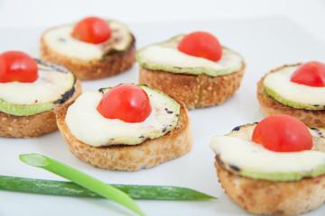 bruschetta (Italian Toasted Bread ) zucchini, tomato,mozzarella