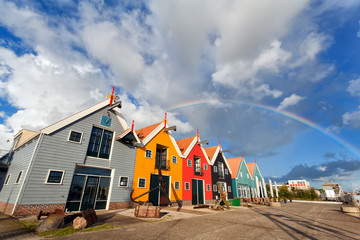 Wall Mural - rainbow over buildings in Zoutkamp