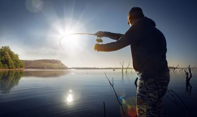 Poster Peche man fishing on a lake