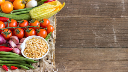 Raw Organic  yellow peas in bowl and vegetables