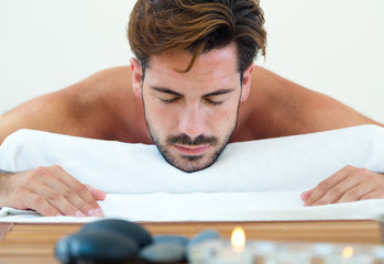 Masseur doing massage on man body in the spa salon.