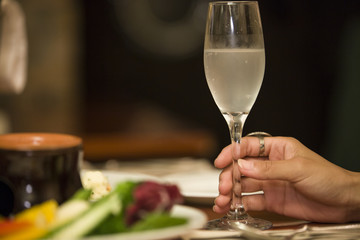 Hands of women with champagne glass