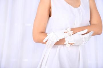 Wedding gloves on  hands of bride, close-up