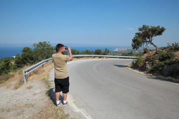 Tourist at road in Greece