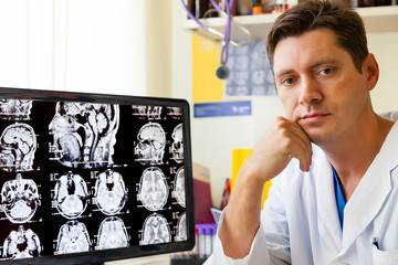 Doctor at monitor with an MRI scan