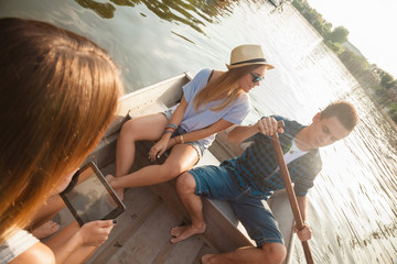 Friends Enjoying On A Boat