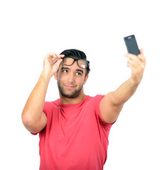 Closeup of young handsome man looking at smartphone and taking s