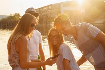 Friends Chilling Having Fun Near Lake