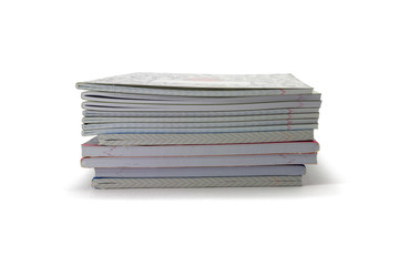 exercise books on a white background