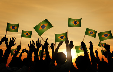 Group of People Waving Brazillian Flags in Back Lit