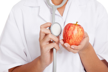Doctor listening to an apple with a stethoscope
