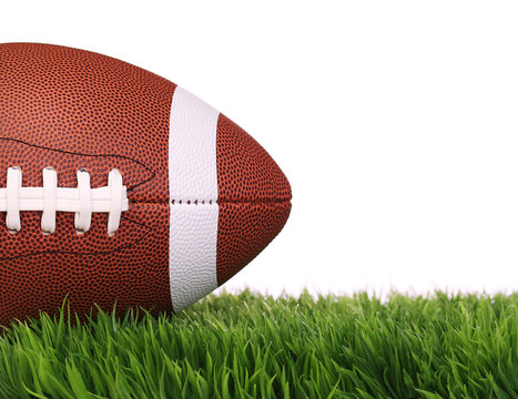 American Football. Ball on Green Grass, isolated on white