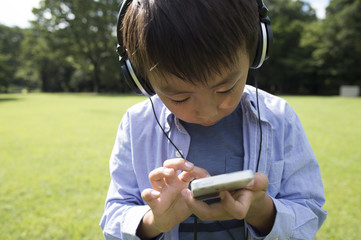 Boy listening to music on a mobile phone
