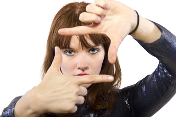 woman in shiny dress with a hand framing gesture