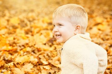 sweet child sitting autumn