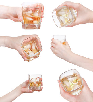 set of hand holds whiskey on ice in glass isolated