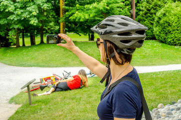 Cyclist Taking a Selfie in a Park