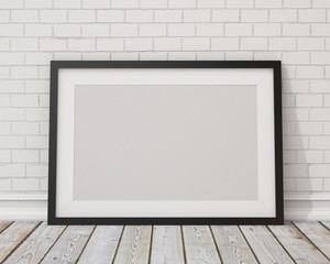 blank black horizontal picture frame on the white concrete wall