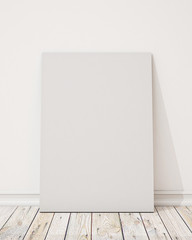 blank poster on the white wall and the wooden floor