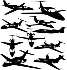 Silhouettes of private jet - contours of airplanes