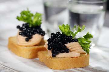 Toats with pate and caviar