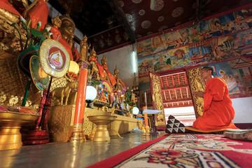 A monk praying in Laos temple