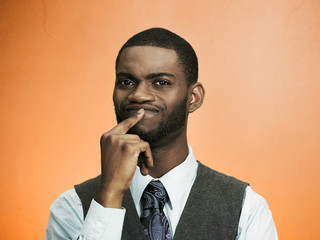 Headshot man thinking, deciding something orange background
