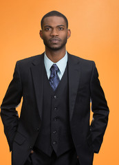 Confident employee, serious young business man in full suit