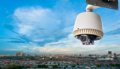 CCTV camera or surveillance with city and construction site in b