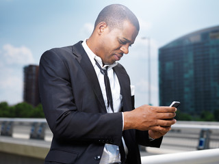african businessman making a call with smartphone