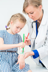 Doctor and little girl drawing. Play therapy concept.