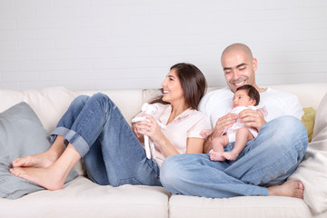 Young parents with little baby at home